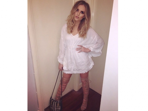Perrie Edwards wearing a white dress and thigh-high boots in Instagram photo