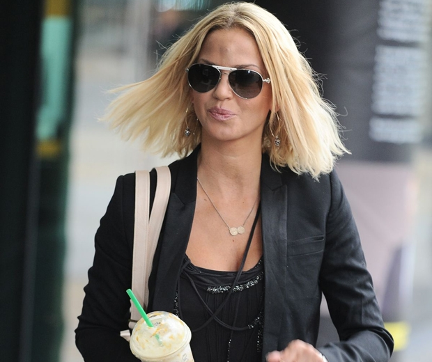 sarah harding in a black jacket and sunglasses
