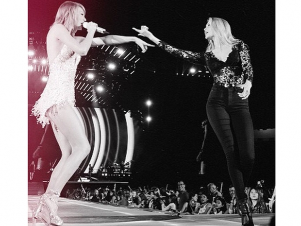 Taylor and Gigi Hadid on stage