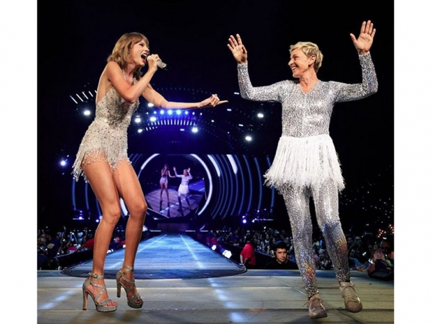 Ellen Degeneres with Taylor Swift on stage.
