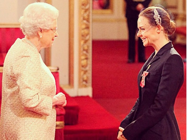 Receiving her OBE from the Queen