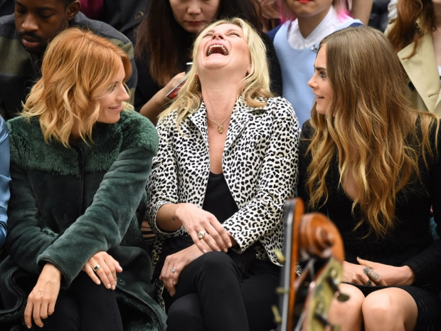 Sienna Miller, Kate Moss and Cara Delevingne share a laugh on the FROW.