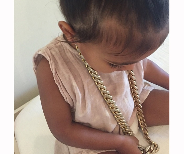 north west in gold chain