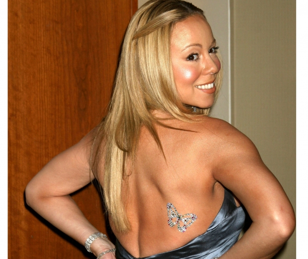 Mariah Carey rules 90s beauty with her diamante tattoos