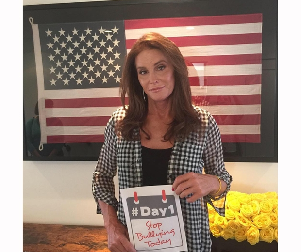 caitlyn jenner holds up anti-bullying sign