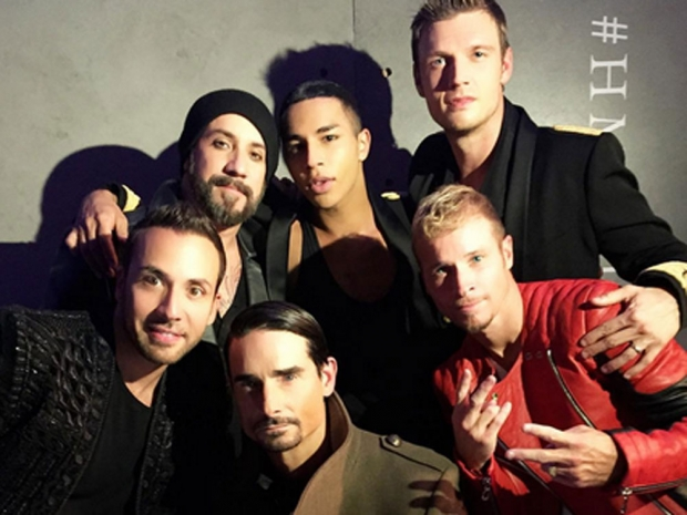 The backstreet boys pose with the man himself.
