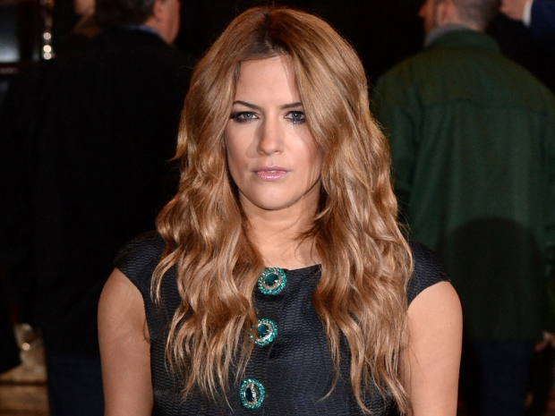 Caroline Flack with long hair out in London