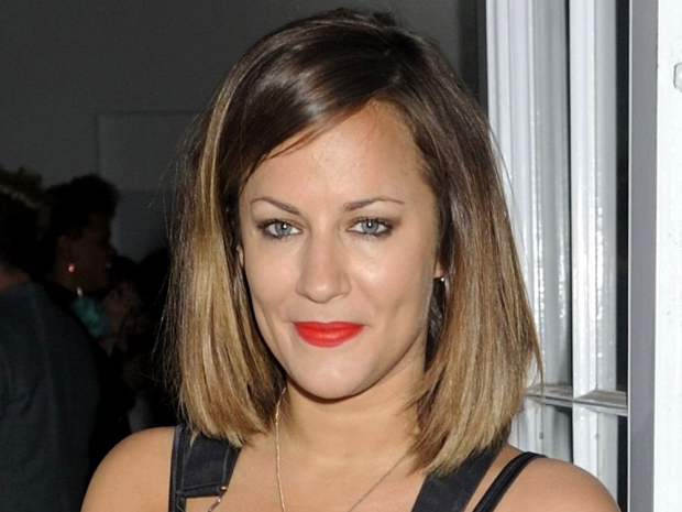 Caroline Flack with a brown shoulder-length style out in London
