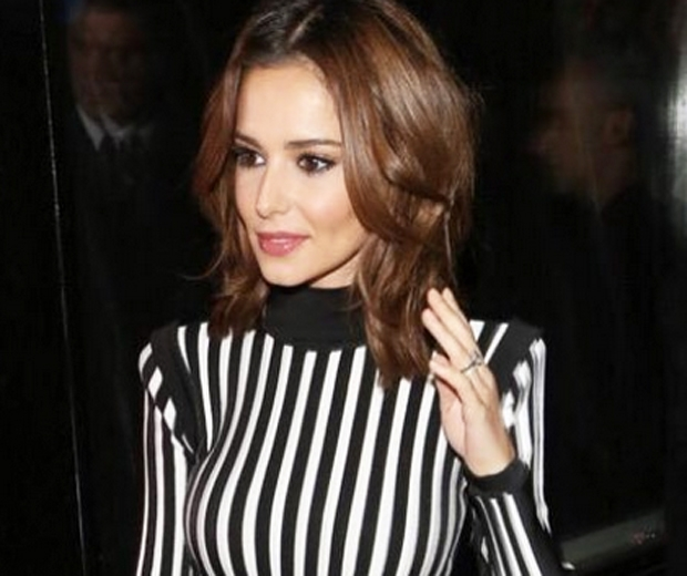 Cheryl Fernandez-Versini in blakc and white stripe dress