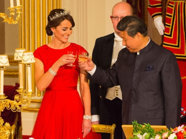 Kate sported a gorgeous red Jenny Packham dress and a Lotus Flower tiara the day