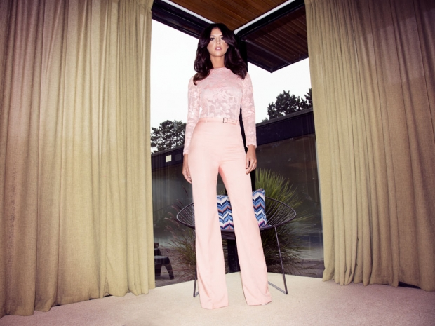 Lucy shows off a seriously Seventies jumpsuit.
