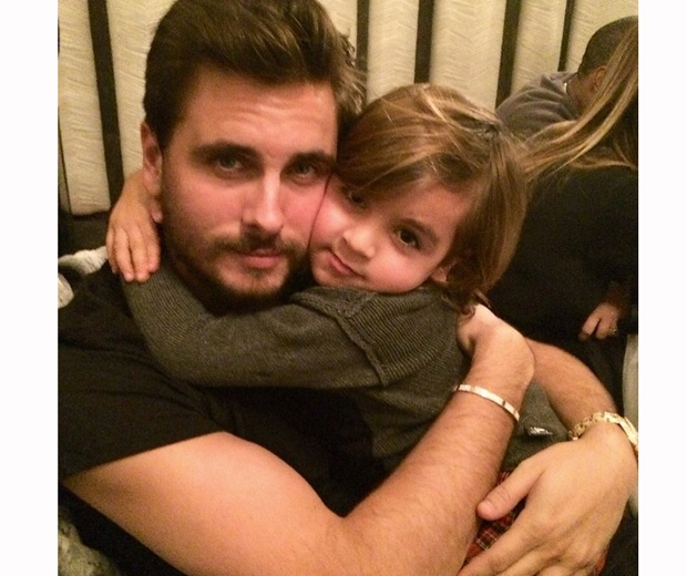 Kourtney shared this photo of Scott and Mason a month ago on Instagram