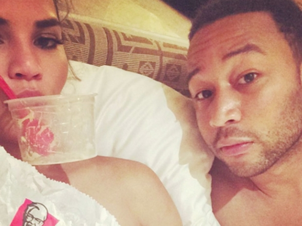 Chrissy Teigen and John Legend in bed eating KFC.