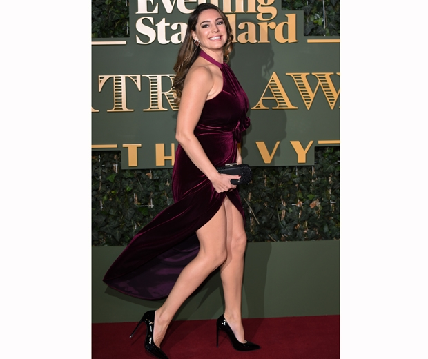 Kelly Brook at Evening Standard Theatre Awards in a red velvet dress