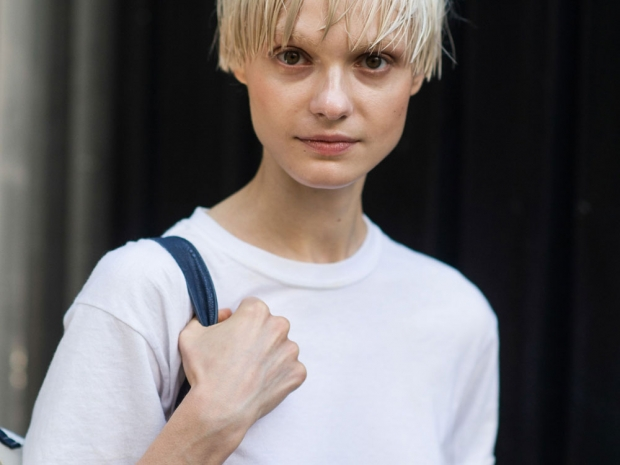 A street styler wearing a white t-shirt.