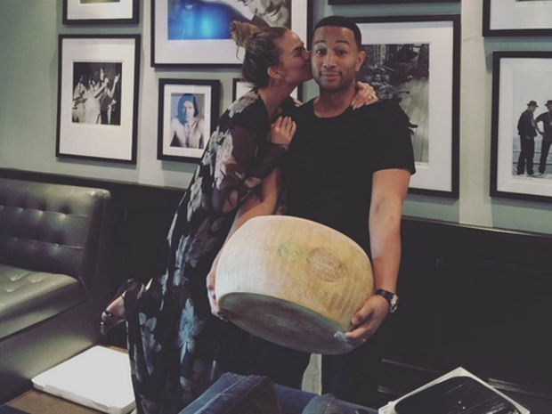 Chrissy Teigen with her wheel of cheese.