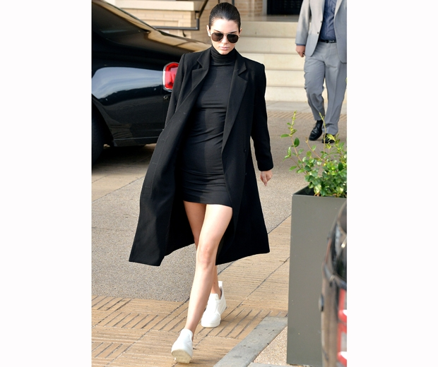 kendall jenner black dress bare legs and trainers