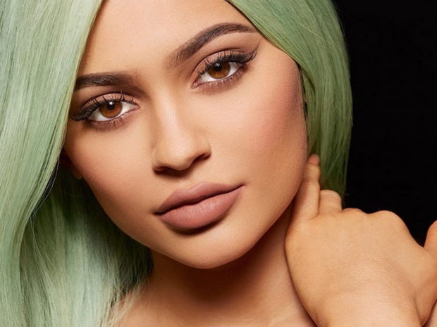 Kylie Jenner with green hair.