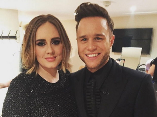 Adele posing for a cheeky snap with Olly Murs on x factor