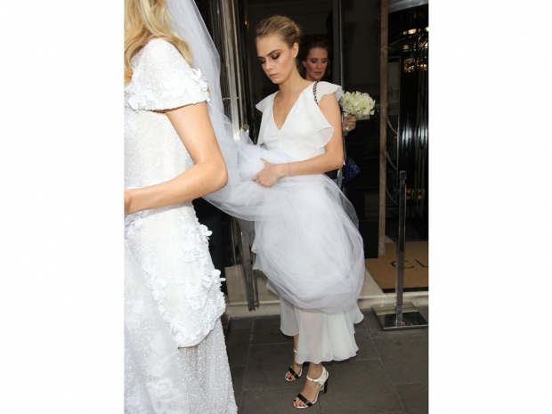 Cara Delevingne playing bridesmaid for her sister Poppy.
