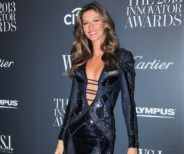 gisele in a navy bodycon dress