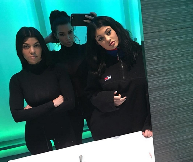 kim and kourtney kardashian with kylie jenner in black bodysuits