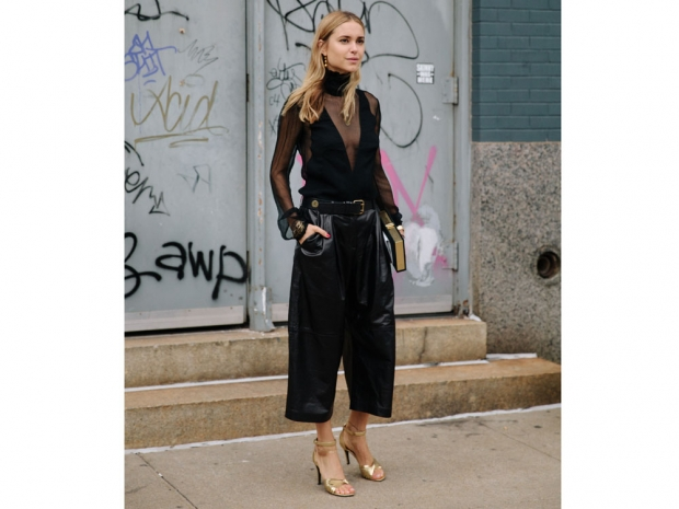 A street styler wearing leather culottes.