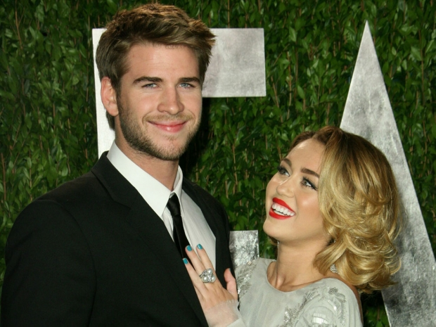 Miley Cyrus and Liam Hemsworth on the red carpet.