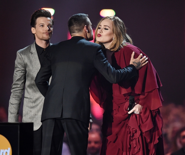Adele was presented an award by Louis Tomlinson and Liam Payne...