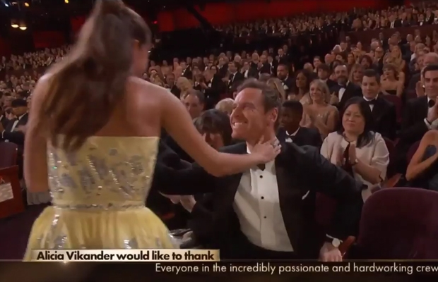 Alicia gave boyfriend Michael Fassbender a big kiss as she scooped the Best Supp