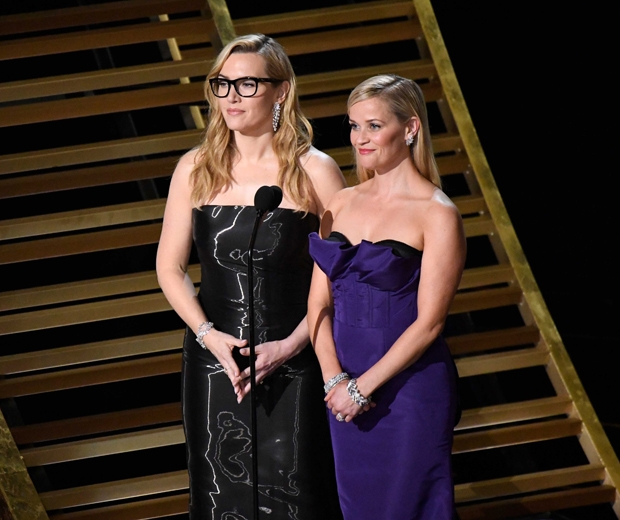 Reese and Kate Winslet on stage at the 2016 Oscars