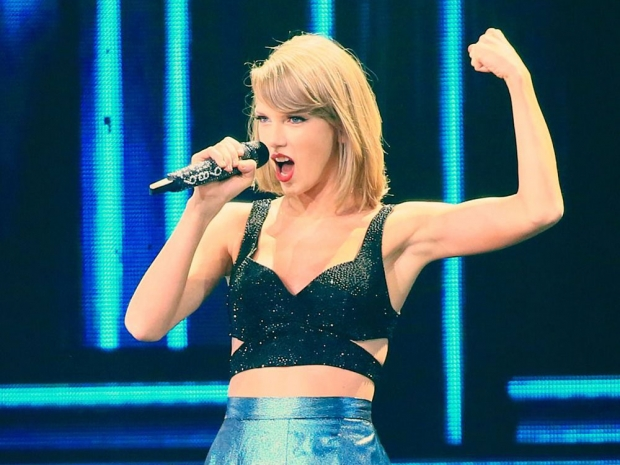 Taylor Swift performing on stage.