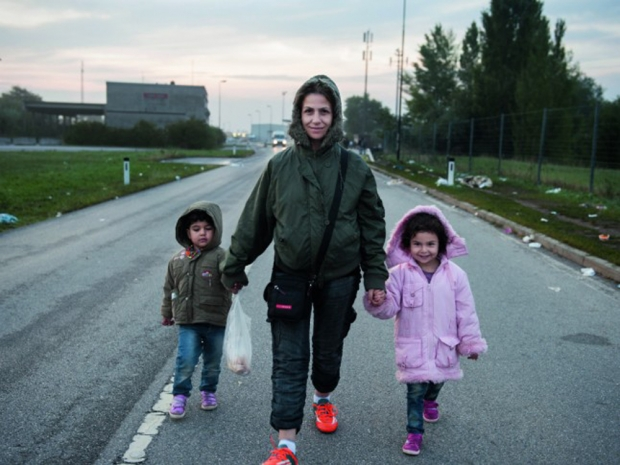 Aysha and her two children travelling from Syria to Germany