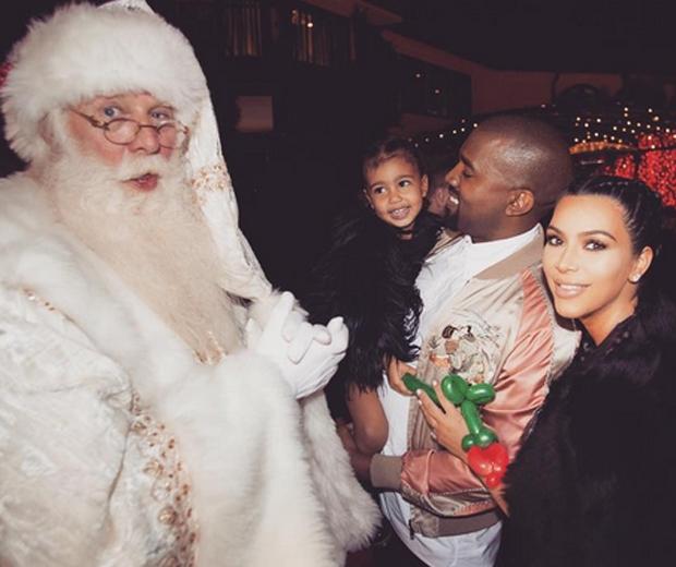 Kim, Kanye and North meeting Santa this year...