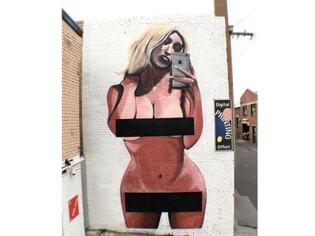 Slut-Shamers Vandalize A Mural of Kim K's Naked Selfie