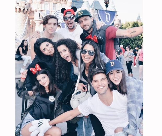 Sonia Ben Ammar and Brooklyn Beckham in Disneyland last week