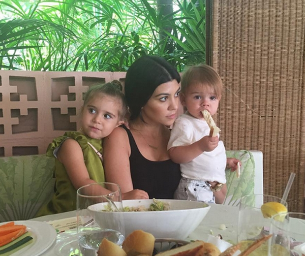 Sister Kourtney with her two children, Penelope and Reign...