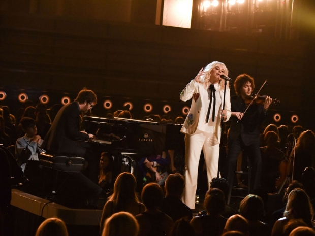 Kesha performed in a white embroidered suit and shirt