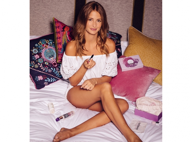 Millie Mackintosh poses with her Birchbox and LOC lip colour