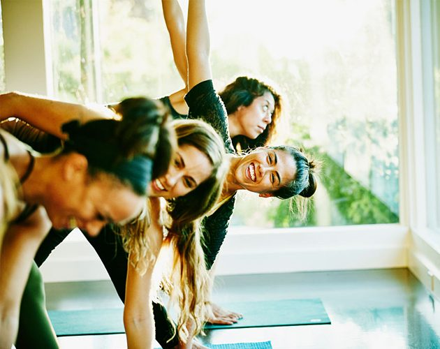 woman-laughing-with-friends-during-yoga-class-picture-hero
