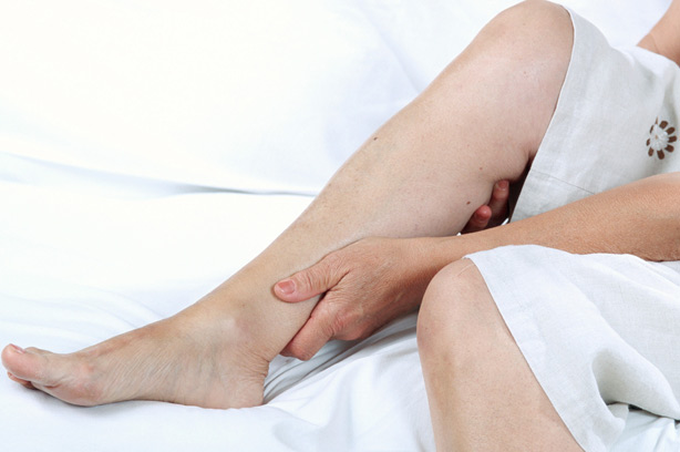 Adult Restless Legs woman cramp pain