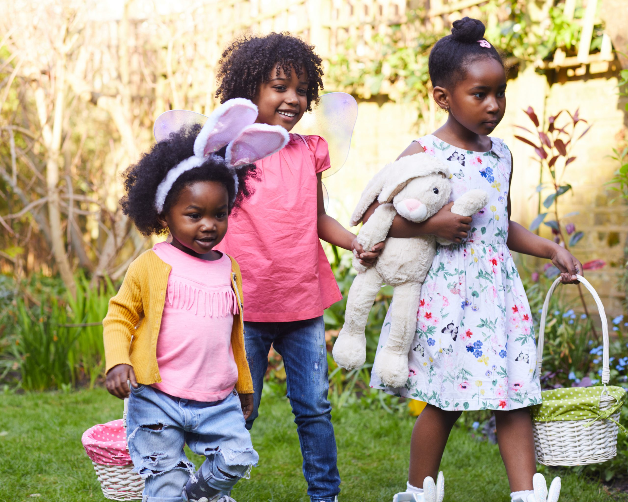 Children taking part in Easter activities and games for kids outside in the garden.