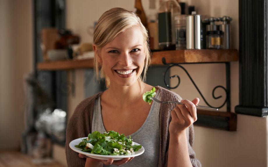 woman eating salad: vegetarian foods
