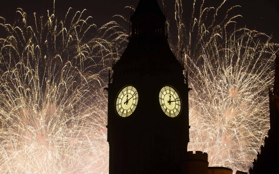 Fireworks behind Big Ben as seen from Parliament Square