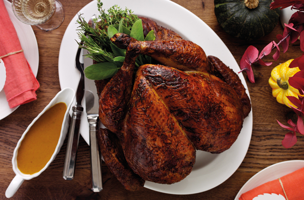 This Thanksgiving roast turkey with a punchy American sauce is a real treat at dinner