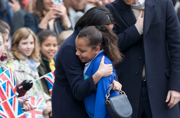 Meghan Markle couldn't help but break royal protocol to hug a 10-year-old school girl in Birmingham