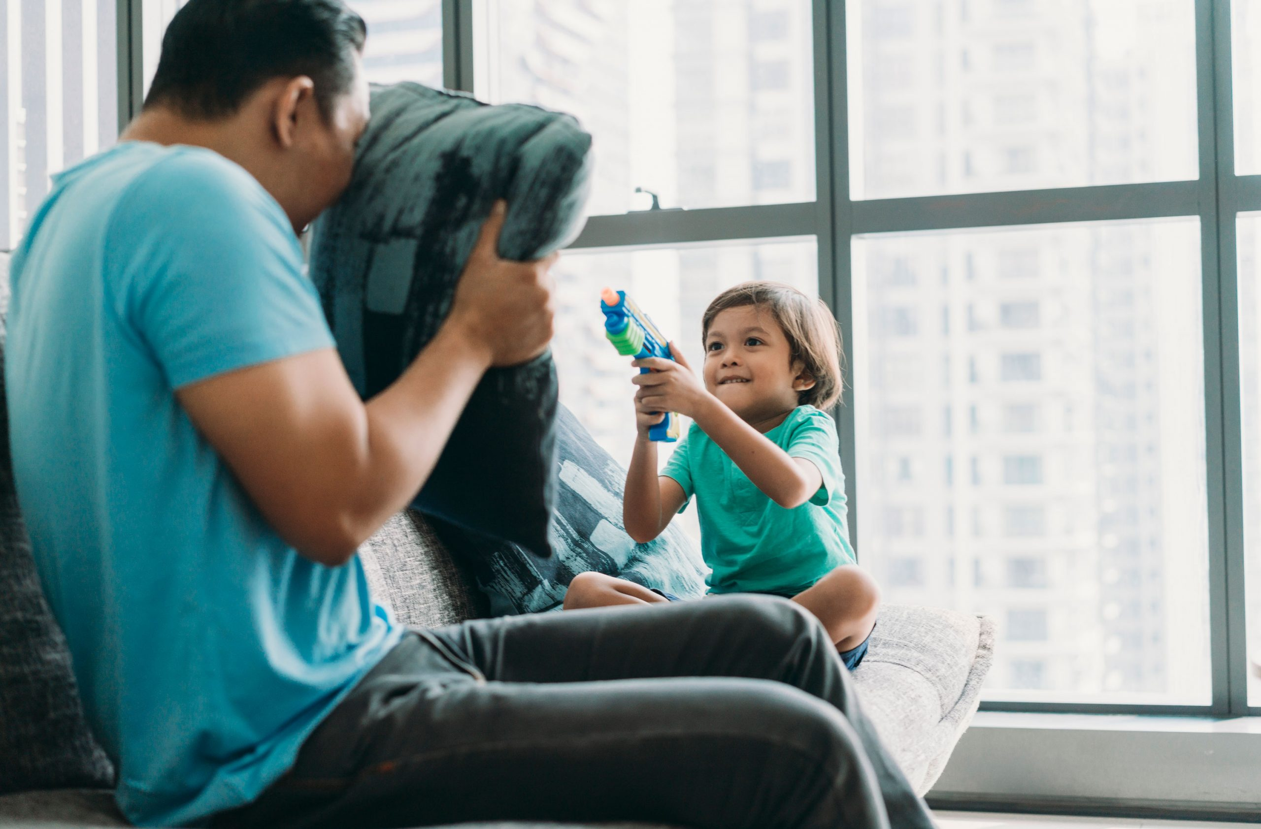 Boy playing with toy gun