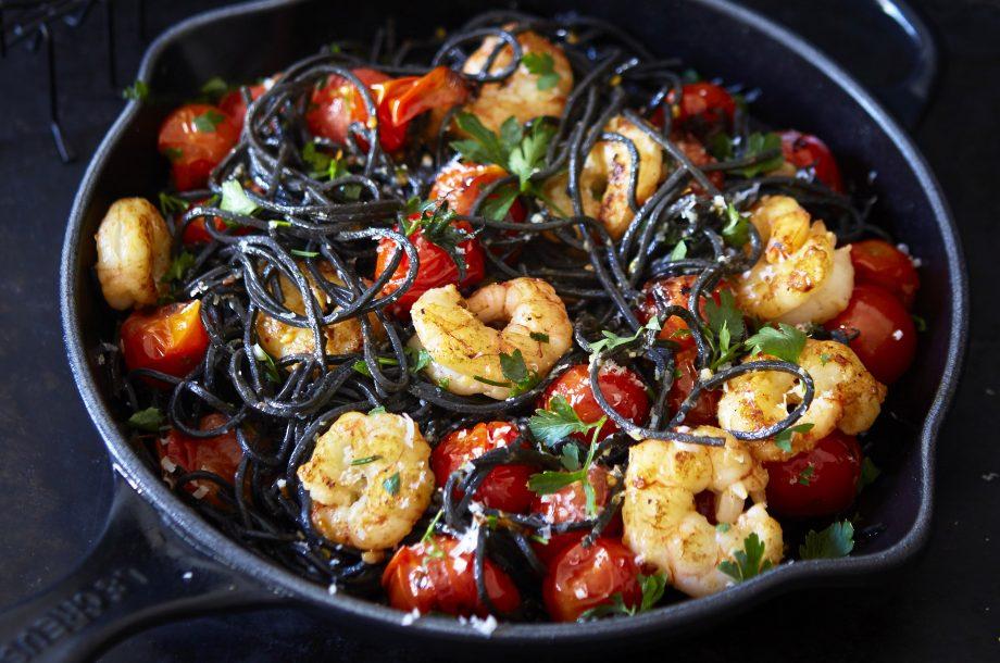 Black pasta with cherry tomatoes and prawns Recipe