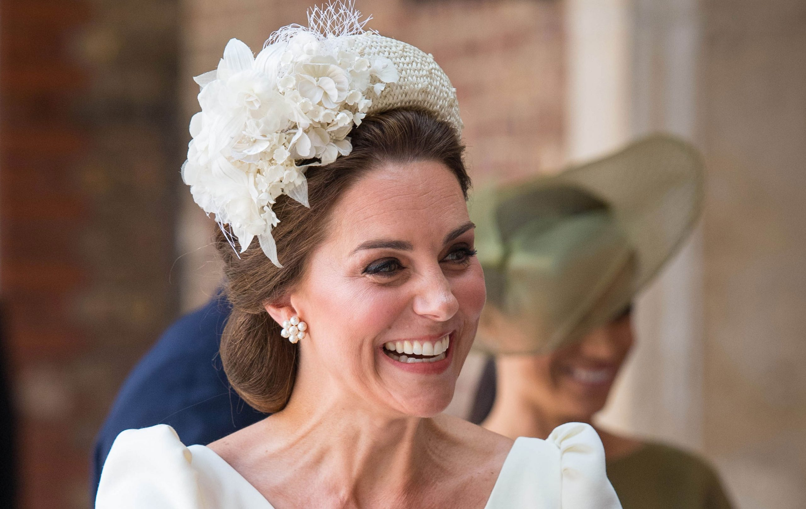 Catherine Duchess of Cambridge carries Prince Louis