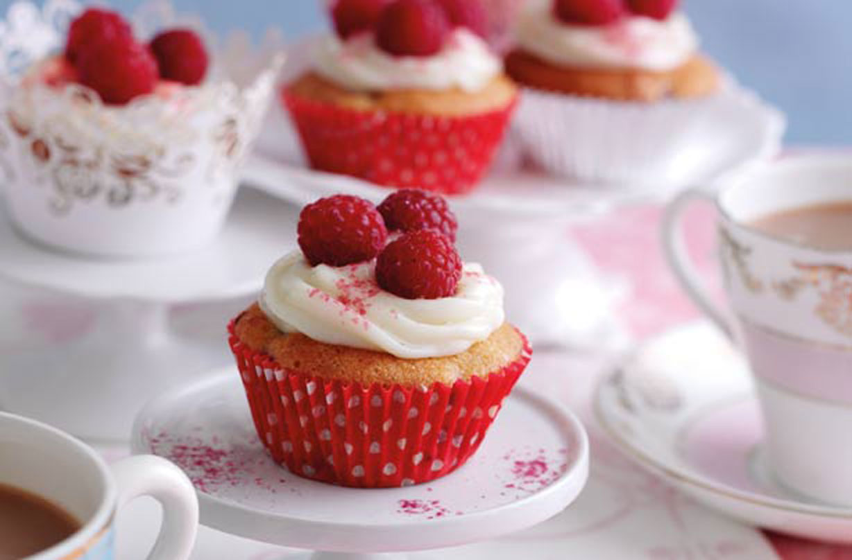 Mother's Day cupcakes with raspberries.